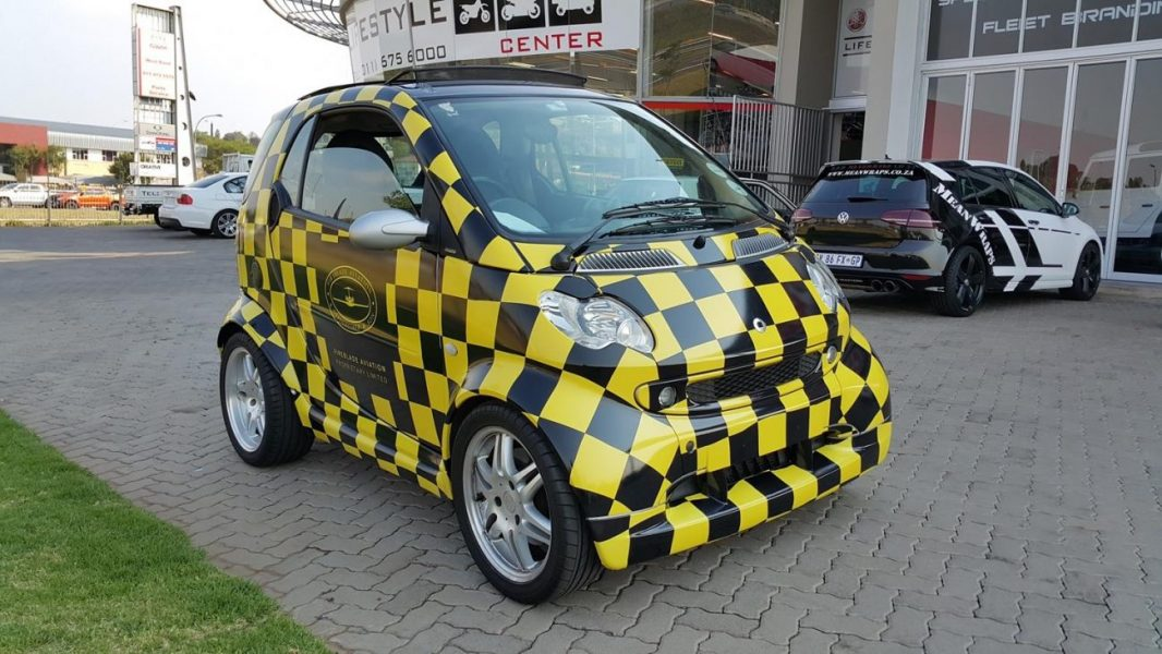 Checkered Branded Vehicle done by Mean Wraps